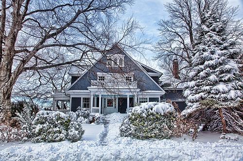 Cape Cod style house in winter snow scene