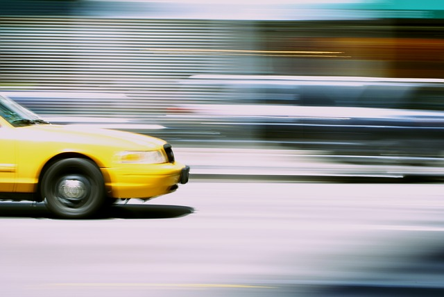 Front of yellow car in motion